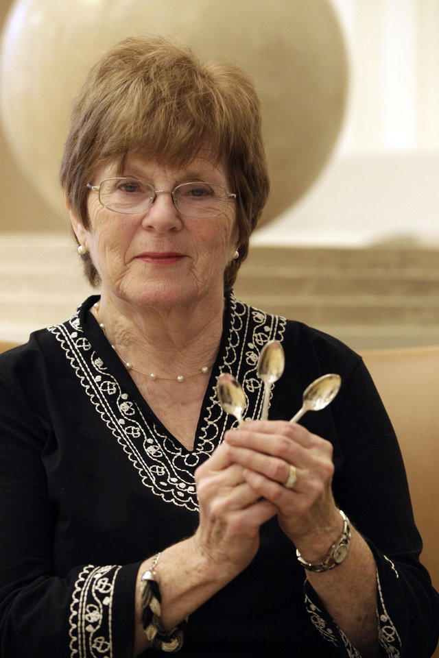 "Photo -   In this Wednesday, Oct. 17 2012 photo, Brigid Brown and native of South Croydon, England, and now living in Somerset, N.J., poses for a portrait with three spoons she returned to the Waldorf Astoria hotel in New York. Dozens of items were returned recently as part of the hotel's ""Amnesty"" program _ no questions asked, unless people volunteer some fascinating stories. (AP Photo/Mary Altaffer)"