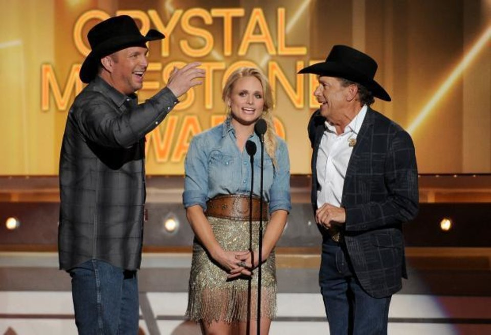 Photo -  Garth Brooks, Miranda Lambert and George Strait pay tribute to Merle Haggard at the 49th annual Academy of Country Music Awards at the MGM Grand Garden Arena on Sunday, April 6, 2014, in Las Vegas. (AP)