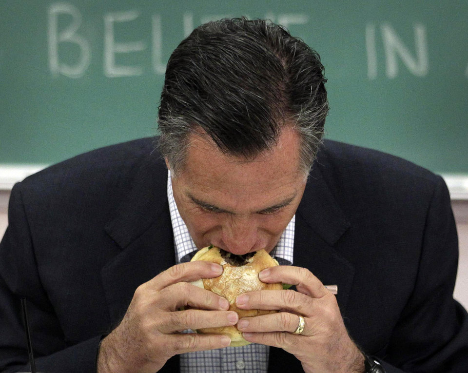 Photo -   FILE - In this April 27, 2012, file photo Republican presidential candidate, former Massachusetts Gov. Mitt Romney, eats a burger before a roundtable discussion with students at Otterbein University in Westerville, Ohio. After days of closed-door fundraisers, Romney reintroduced himself to a nation, his first public appearance since becoming the presumptive Republican presidential nominee, and offered a window into his campaign's evolving strategy as he moves beyond the bitter GOP primary. (AP Photo/Jae C. Hon, File)