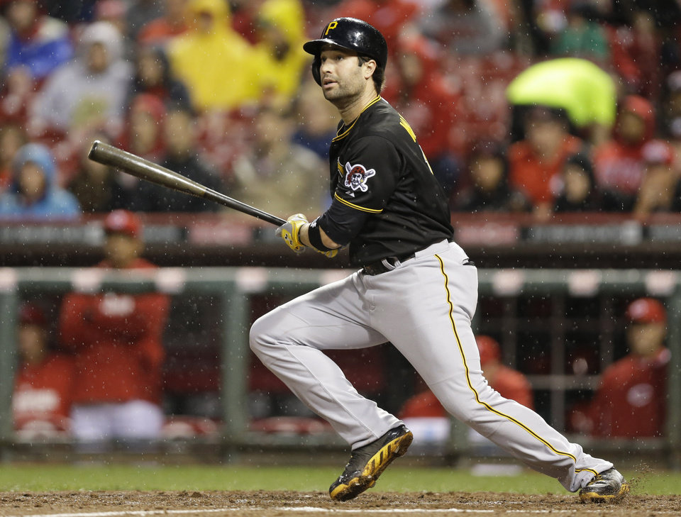 Photo - Pittsburgh Pirates' Neil Walker gets a hit off Cincinnati Reds starting pitcher Homer Bailey in the fourth inning of a baseball game, Monday, April 14, 2014, in Cincinnati. (AP Photo/Al Behrman)