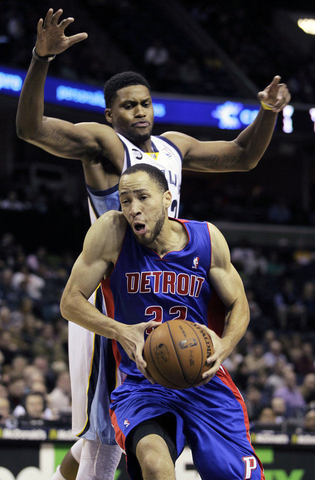 Detroit Pistons' Tayshaun Prince (22) goes to the basket under Memphis Grizzlies' Rudy Gay, top, in the first half of an NBA basketball game in Memphis, Tenn., Friday, Nov. 30, 2012. (AP Photo/Danny Johnston)