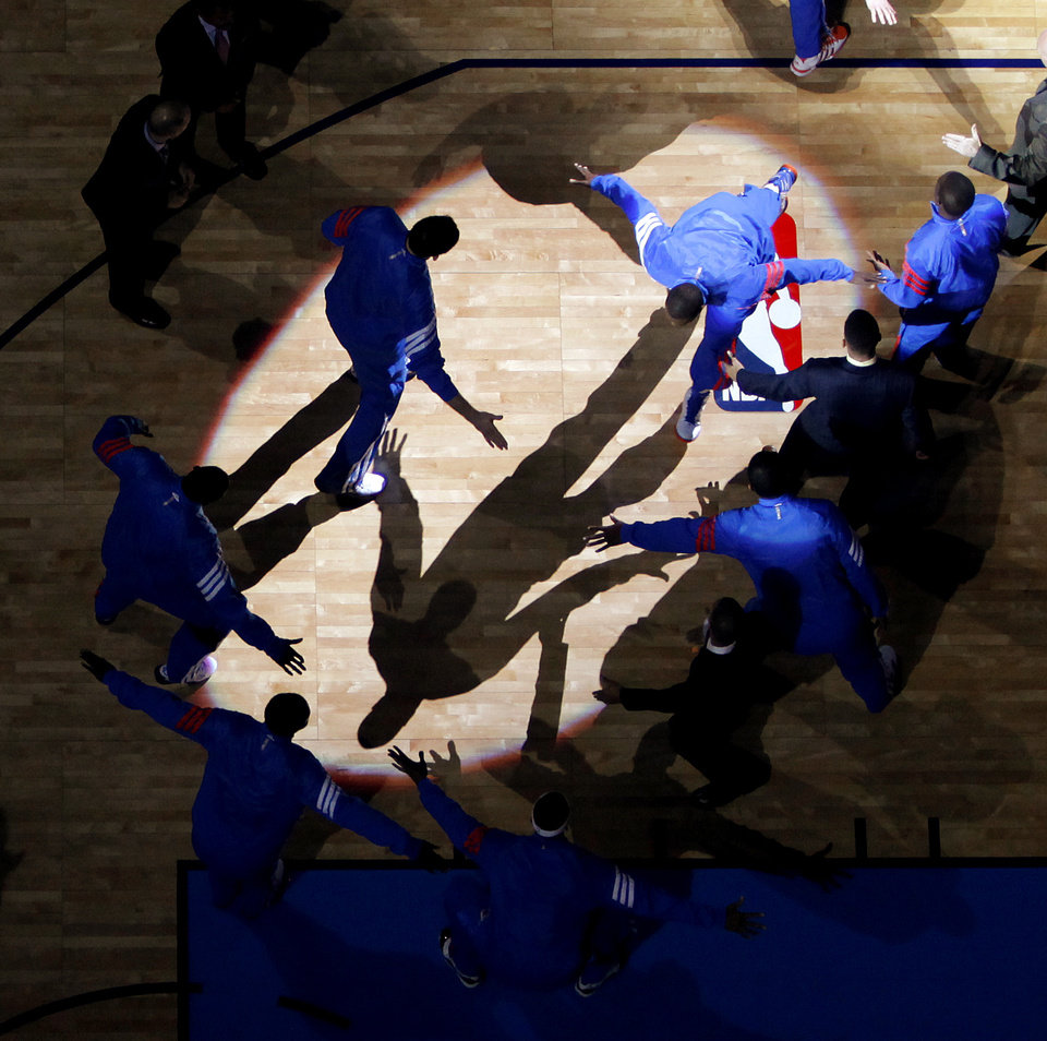 Photo - Oklahoma City's Serge Ibaka is introduced to the cord before the NBA basketball game between the Oklahoma City Thunder and the Cleveland Cavaliers at Chesapeake Energy Arena in Oklahoma City, Friday, March 9, 2012. Photo by Bryan Terry, The Oklahoman