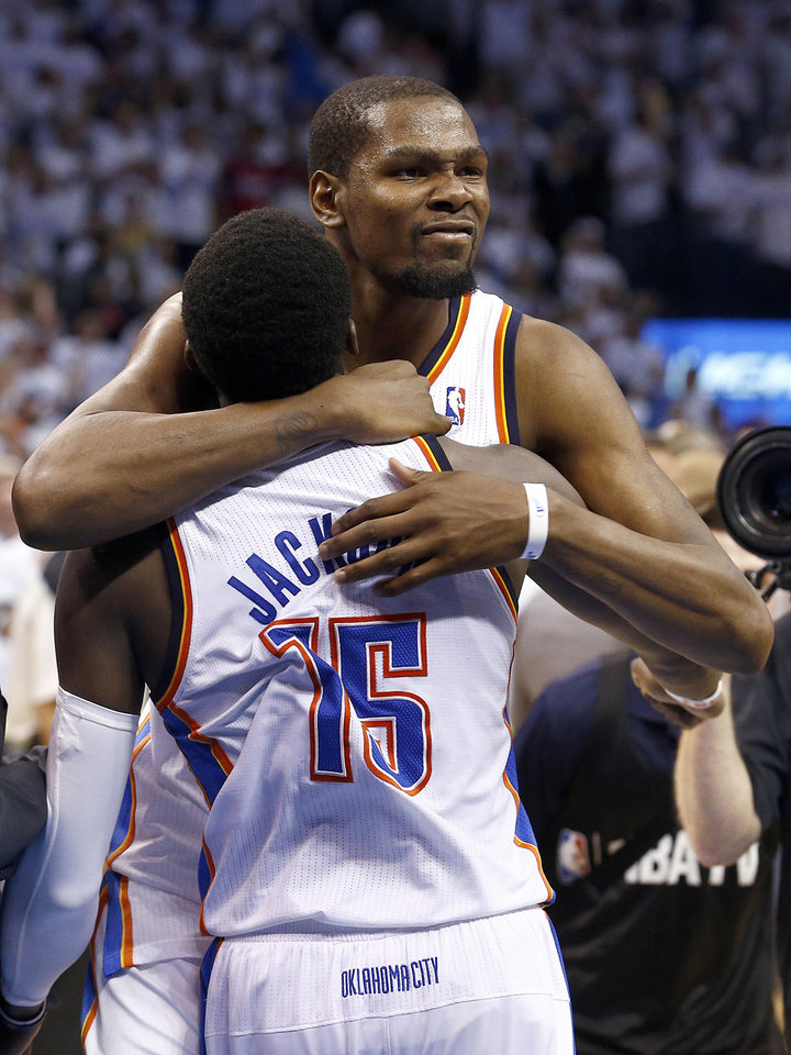 Oklahoma City's Kevin Durant (35) hugs Reggie Jackson (15) follow the Thunder's win during Game 5 of the Western Conference semifinals in the NBA playoffs between the Oklahoma City Thunder and the Los Angeles Clippers at Chesapeake Energy Arena in Oklahoma City, Tuesday, May 13, 2014. Photo by Sarah Phipps, The Oklahoman