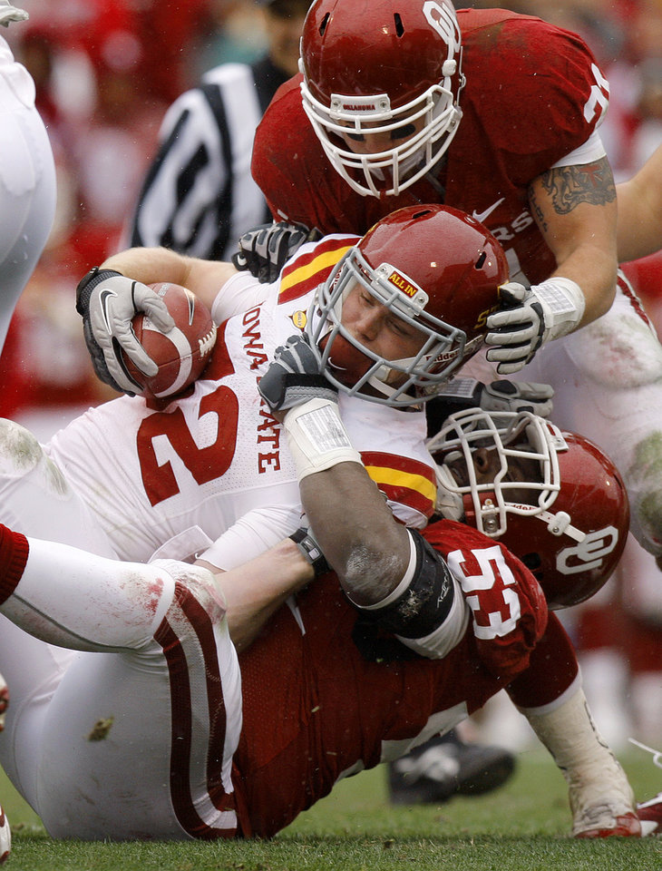 Oklahoma's Casey Walker (53) and Tom Wort (21) bring down Iowa State's Jeff Woody (32) during a college football game between the University of Oklahoma Sooners (OU) and the Iowa State University Cyclones (ISU) at Gaylord Family-Oklahoma Memorial Stadium in Norman, Okla., Saturday, Nov. 26, 2011. Photo by Bryan Terry, The Oklahoman