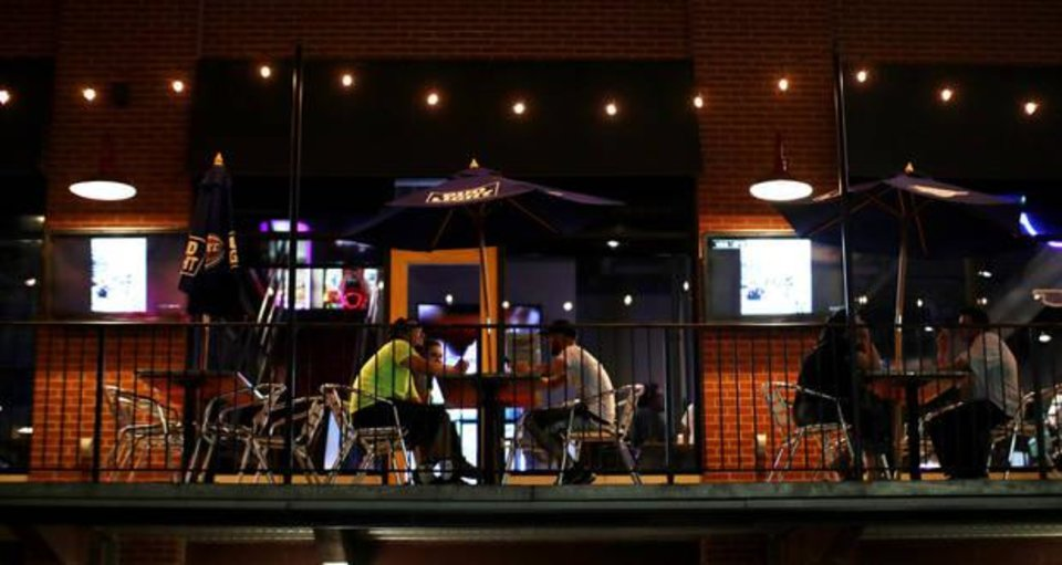 Photo -  The sights on the balcony at Brickopolis in Bricktown. [PHOTO BY DOUG HOKE, THE OKLAHOMAN]