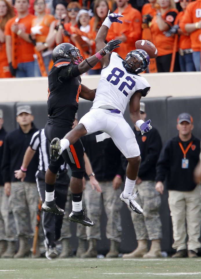 Oklahoma State\'s Daytawion Lowe (8) breaks up a pass intended for TCU\'s Josh Boyce (82) during a college football game between Oklahoma State University (OSU) and Texas Christian University (TCU) at Boone Pickens Stadium in Stillwater, Okla., Saturday, Oct. 27, 2012. Photo by Sarah Phipps, The Oklahoman
