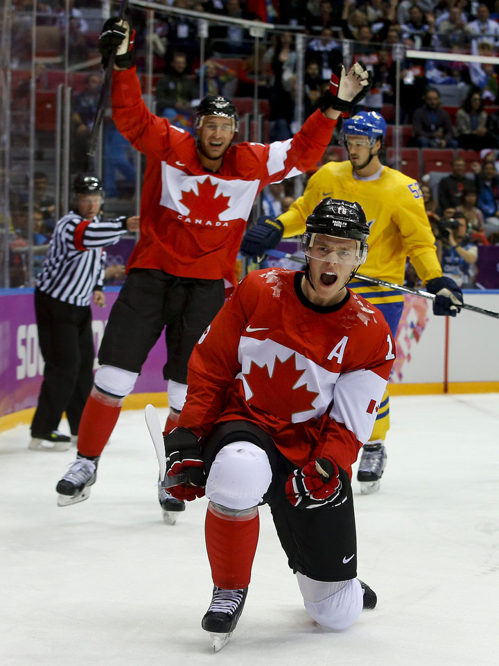 Photo - Canada forward Jonathan Toews reacts after scoring a goal against Sweden during the first period of the men's gold medal ice hockey game at the 2014 Winter Olympics, Sunday, Feb. 23, 2014, in Sochi, Russia. (AP Photo/Matt Slocum)
