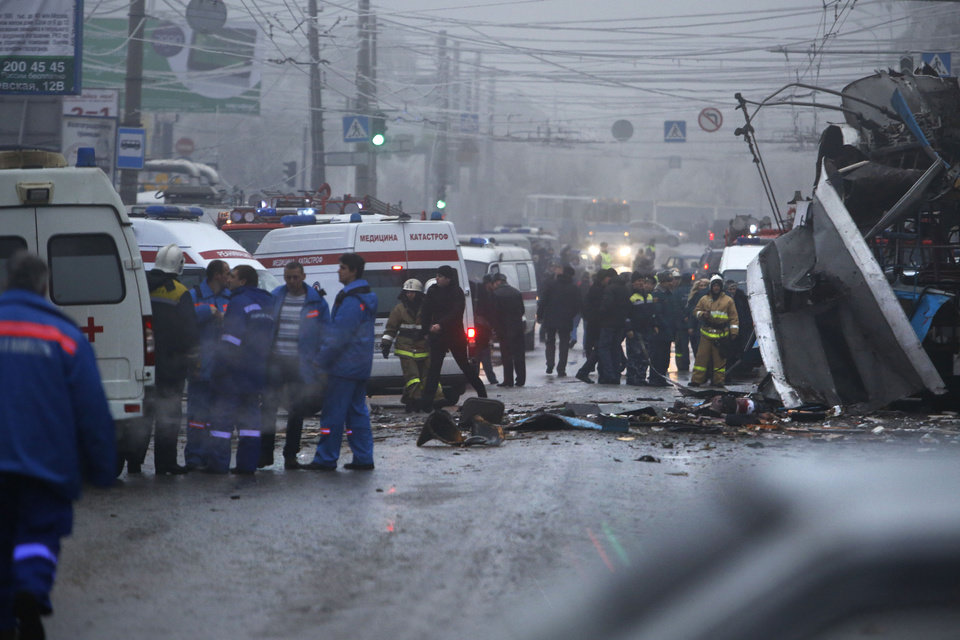 Photo - Experts, firefighters and police officers examine a site of a trolleybus explosion in Volgograd, Russia Monday, Dec. 30, 2013. A bomb blast tore through the trolleybus in the city of Volgograd on Monday morning, killing at least 10 people a day after a suicide bombing that killed at 17 at the city's main railway station. (AP Photo/Denis Tyrin)