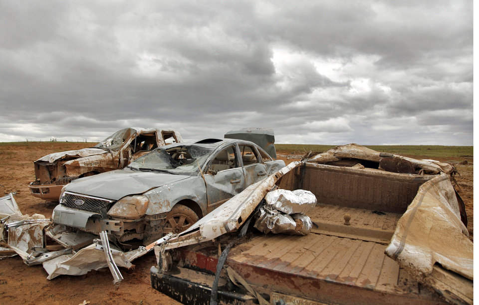 Photo - A row of tornado destroyed cars at the home of Jesse and Miranda Lewis west of El Reno, Wednesday, May 25, 2011. Photo by Chris Landsberger, The Oklahoman