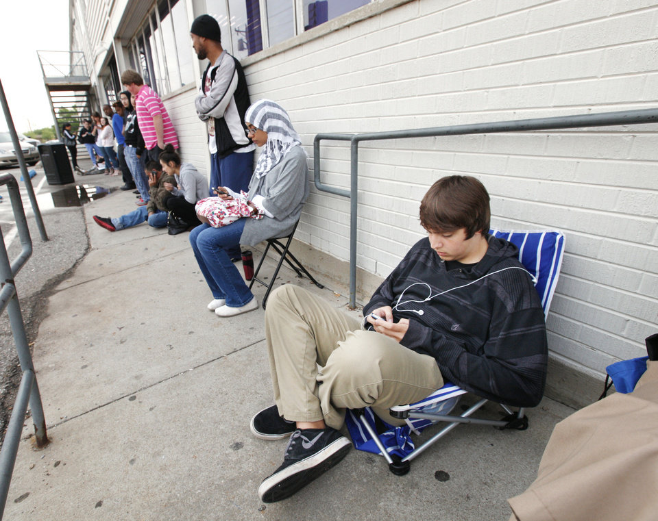 Photo - Edmond North High School sophomore Aaron Andeel, far right, age 16, waits in line for the Okla. Department of Public Safety driver license testing facility to open in downtown Edmond Friday, May 10, 2013.  Photo by Paul B. Southerland, The Oklahoman