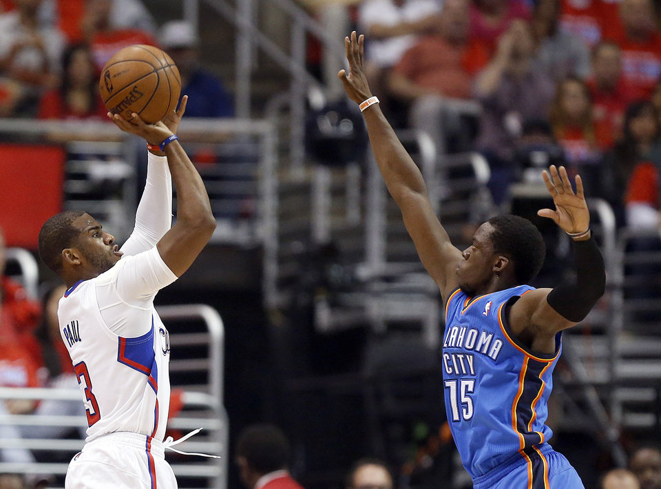 Photo - Los Angeles' Chris Paul (3) shoots as Oklahoma City's Reggie Jackson (15) defends during Game 3 of the Western Conference semifinals in the NBA playoffs between the Oklahoma City Thunder and the Los Angeles Clippers at the Staples Center in Los Angeles, Friday, May 9, 2014. Photo by Nate Billings, The Oklahoman