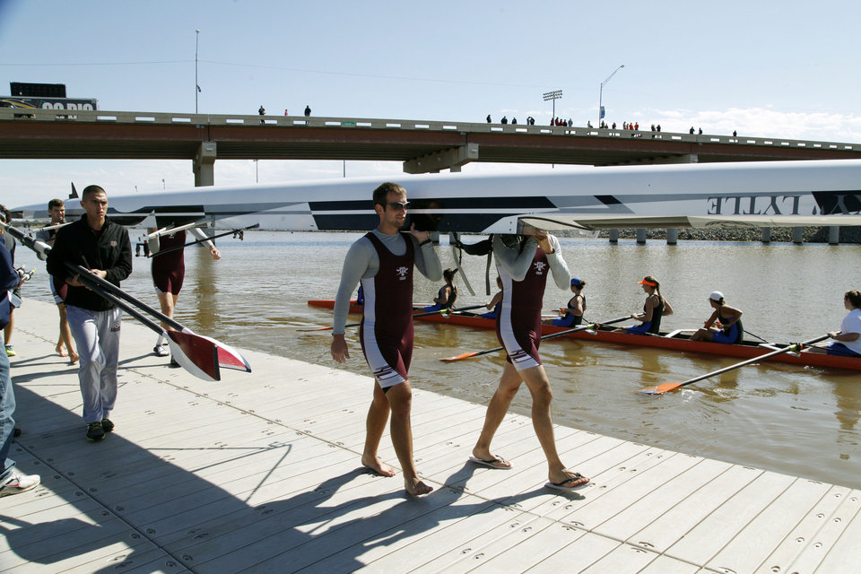 The Texas A&M A team walks their rowing shell to the river during the Oklahoma Regatta Festival on the Oklahoma River in Oklahoma City, OK, Saturday, October 5, 2013,  Photo by Paul Hellstern, The Oklahoman