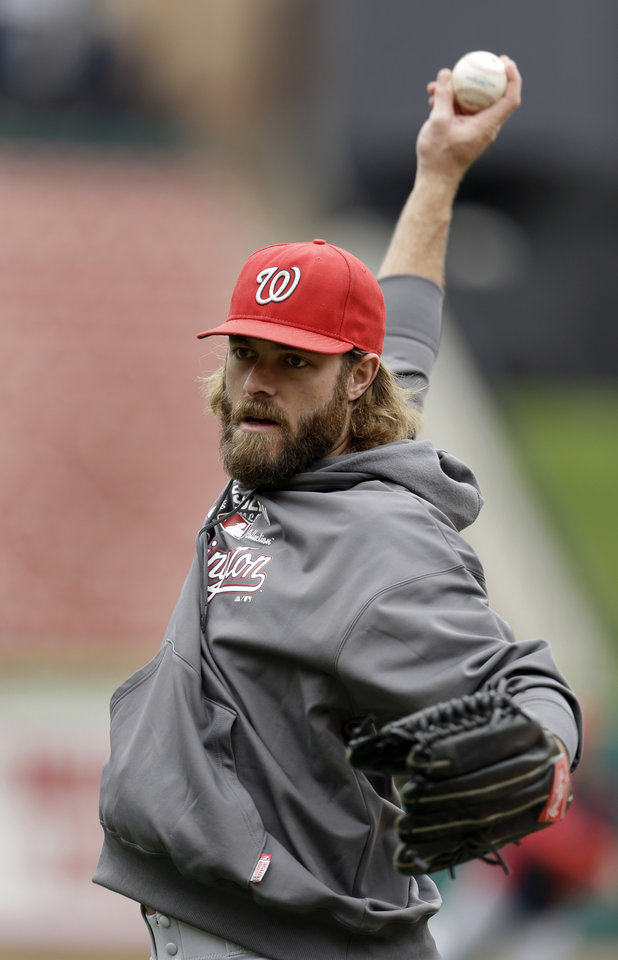 Washington Nationals\' Jayson Werth stretches his arm during baseball practice, Saturday, Oct. 6, 2012, in St. Louis. The Nationals and the St. Louis Cardinals are scheduled to play Game 1 in the National League division series on Sunday. (AP Photo/Jeff Roberson)