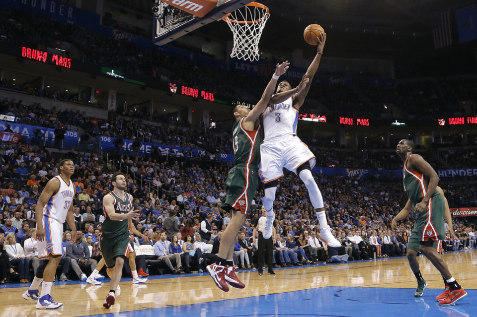 Oklahoma City's Perry Jones (3) shoots over Milwaukee 's Gustavo Ayon (19) during the season finally NBA basketball game between the Oklahoma City Thunder and the Milwaukee Bucks at Chesapeake Energy Arena on Wednesday, April 17, 2013, in Oklahoma City, Okla.   Photo by Chris Landsberger, The Oklahoman