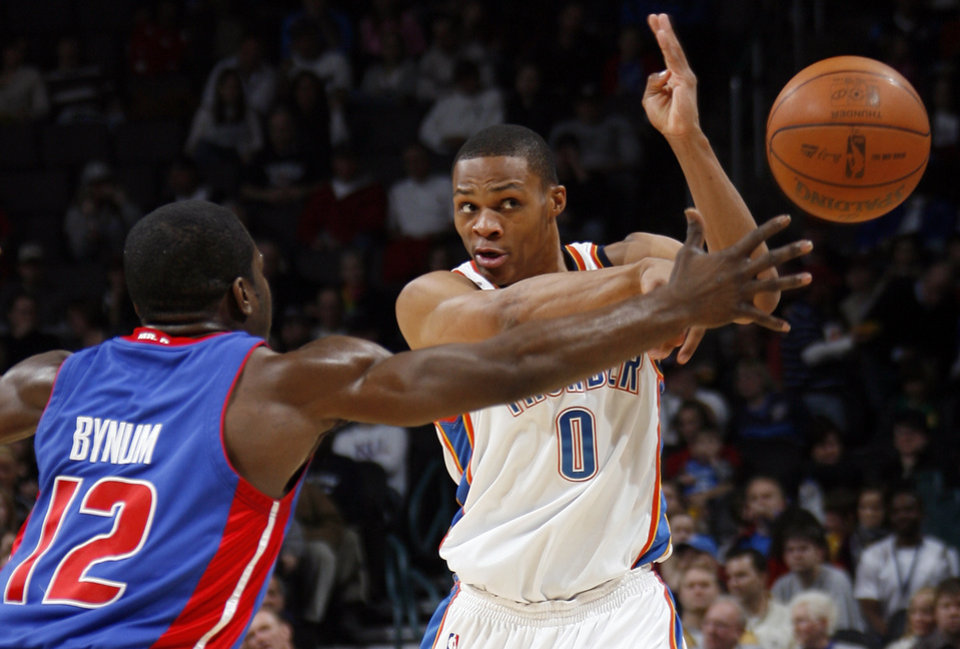 Russell Westbrook (0) of Oklahoma City passes the ball away from Will Bynum (12) of Detroit in the first half during the NBA basketball game between the Oklahoma City Thunder and the Detroit Pistons at the Ford Center in Oklahoma City, Friday, December 18, 2009. Photo by Nate Billings, The Oklahoman ORG XMIT: KOD