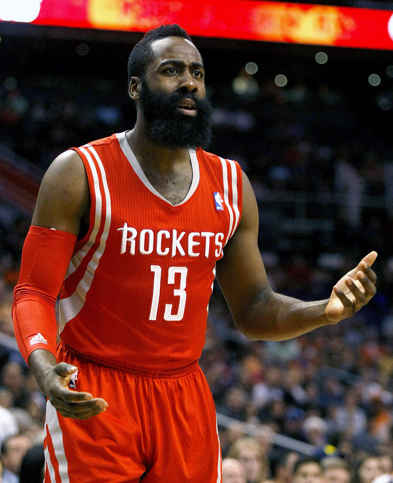 Photo - Houston Rockets shooting guard James Harden (13) reacts to a no call in the first quarter during an NBA basketball game against the Phoenix Suns, Sunday, Feb. 23, 2014, in Phoenix. (AP Photo/Rick Scuteri)