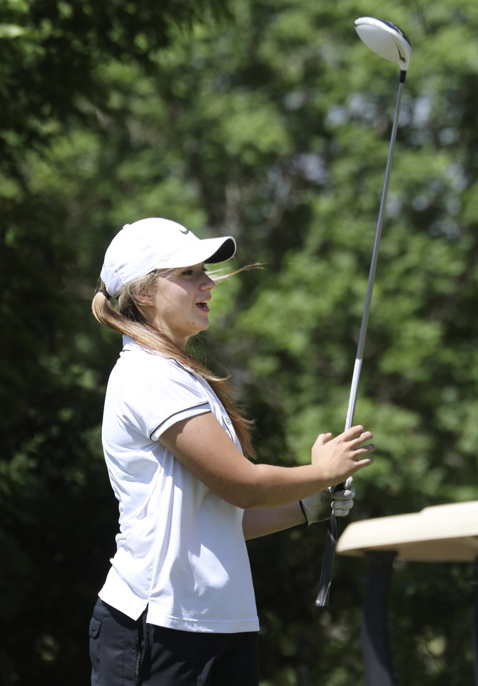 Photo - Bethany sophomore Gabby Gomez watches a tee shot at Lake Hefner golf course in Oklahoma City,  Wednesday May 07, 2014. Photo By Steve Gooch, The Oklahoman