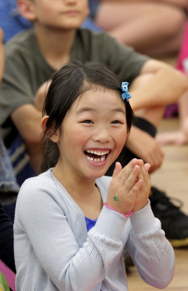 Photo -  Jessie Wong, 6, laughs with other children during Physics Fun House at the Norman Public Library. PHOTO BY JIM BECKEL, THE OKLAHOMAN   Jim Beckel -
