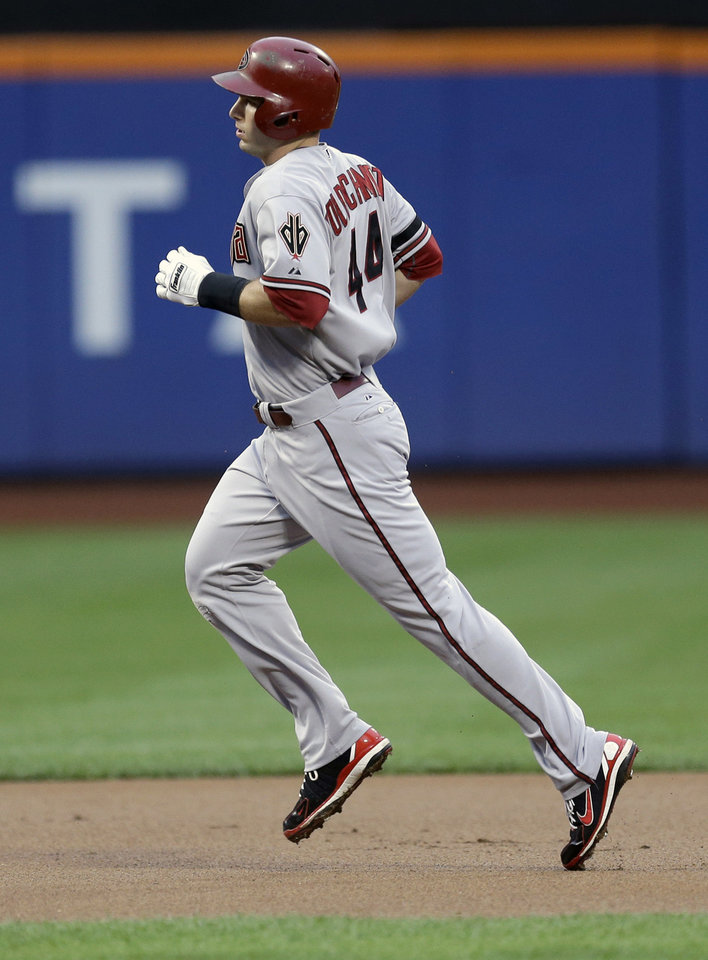 Photo - Arizona Diamondbacks' Paul Goldschmidt rounds the bases after hitting a two-run homer during the first inning of the baseball game against the New York Mets at Citi Field, Monday, July 1, 2013, in New York. (AP Photo/Seth Wenig)