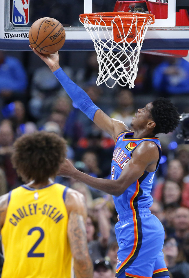 Photo - Oklahoma City's Shai Gilgeous-Alexander (2) goes up for a basket as Golden State's Willie Cauley-Stein (2) looks on during the NBA game between the Oklahoma City Thunder and the Golden State Warriors at Chesapeake Energy Arena,   Saturday, Nov. 9, 2019.  [Sarah Phipps/The Oklahoman]