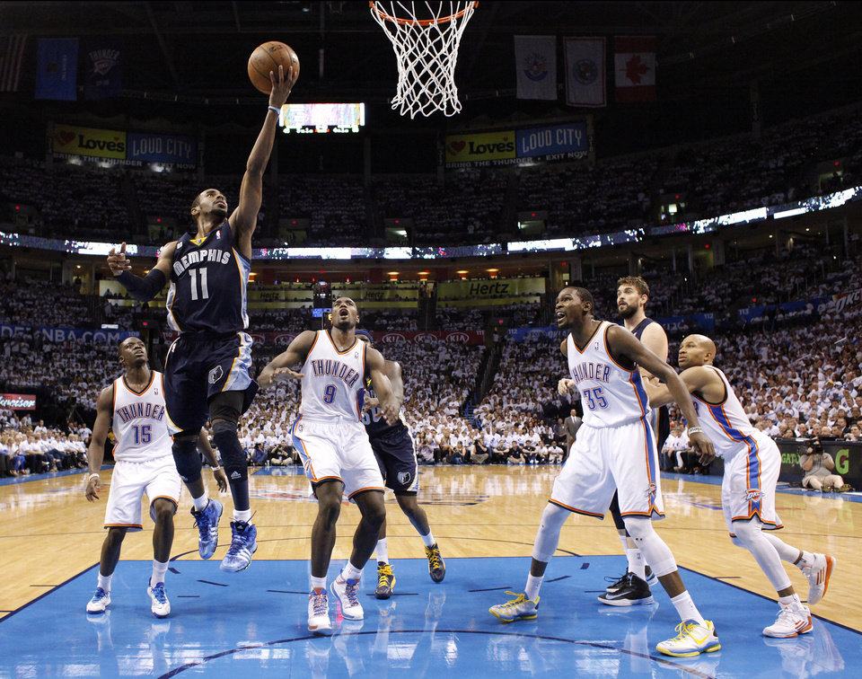 Memphis' Mike Conley (11) shoots a lay in front of Oklahoma City's Reggie Jackson (15), Oklahoma City's Serge Ibaka (9), Oklahoma City's Kevin Durant (35) and Oklahoma City's Derek Fisher (6) during Game 5 in the second round of the NBA playoffs between the Oklahoma City Thunder and the Memphis Grizzlies at Chesapeake Energy Arena in Oklahoma City, Wednesday, May 15, 2013. Photo by Sarah Phipps, The Oklahoman