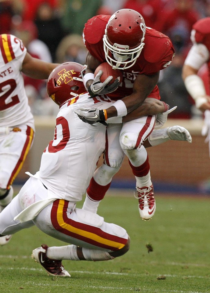 Oklahoma's Roy Finch (22) is brought down by Iowa State's Jacques Washington (10) during a college football game between the University of Oklahoma Sooners (OU) and the Iowa State University Cyclones (ISU) at Gaylord Family-Oklahoma Memorial Stadium in Norman, Okla., Saturday, Nov. 26, 2011. Photo by Bryan Terry, The Oklahoman