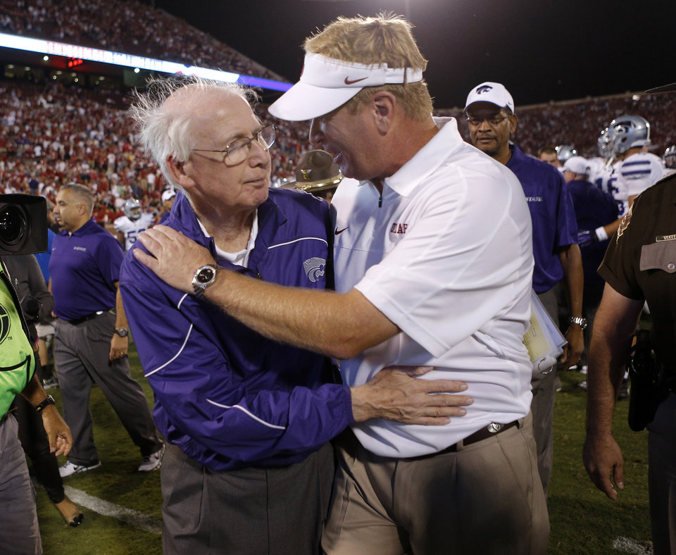 Photo - Kansas State coach Bill Snyder talks with Oklahoma defensive coordinator Mike Stoops after a college football game between the University of Oklahoma Sooners (OU) and the Kansas State University Wildcats (KSU) at Gaylord Family-Oklahoma Memorial Stadium, Saturday, September 22, 2012. Oklahoma lost 24-19. Photo by Bryan Terry, The Oklahoman