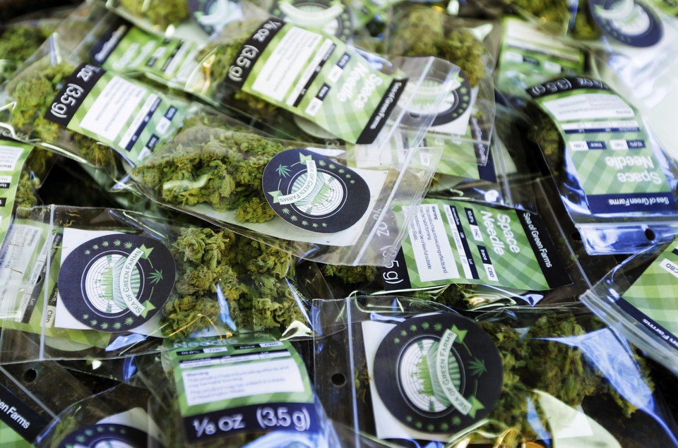Photo - This July 1, 2014, photo shows packets of a variety of recreational marijuana named