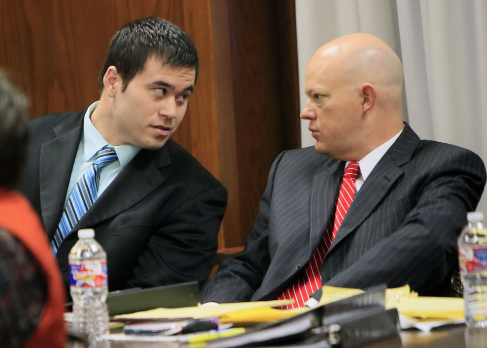 Photo - Daniel Holtzclaw speaks to his attorneys in Judge Henderson's courtroom at the Oklahoma County Courthouse in Oklahoma City, OK, as jurors hear closing arguments in his case and decide on a verdict, Monday, December 7, 2015,  Photo by Paul Hellstern, The Oklahoman