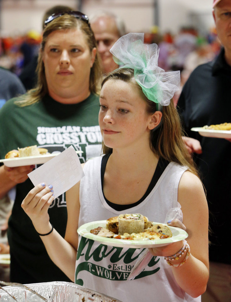 Alix Court, a senior at Norman North High School, participates in Taste of Norman, which raises money for music programs at the city\'s two high schools. PHOTO BY STEVE SISNEY, THE OKLAHOMAN STEVE SISNEY