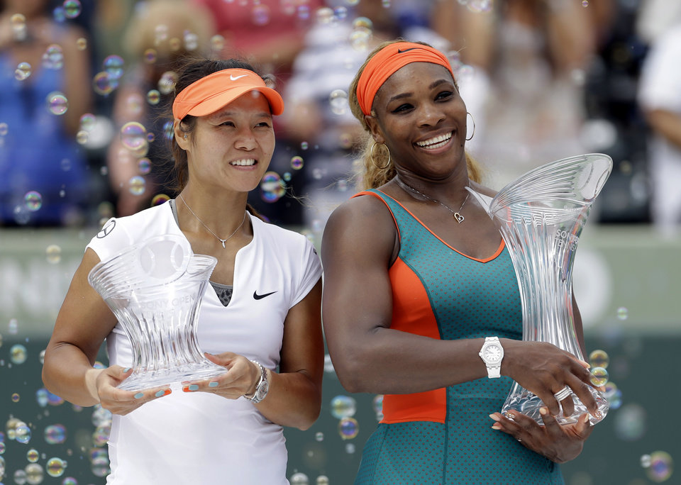 Photo - Serena Williams, right, of the United States, and Li Na, of China, pose for photos after the trophy presentation for the women's final at the Sony Open Tennis tournament in Key Biscayne, Fla., Saturday, March 29, 2014. Williams won 7-5, 6-1. (AP Photo/Alan Diaz)