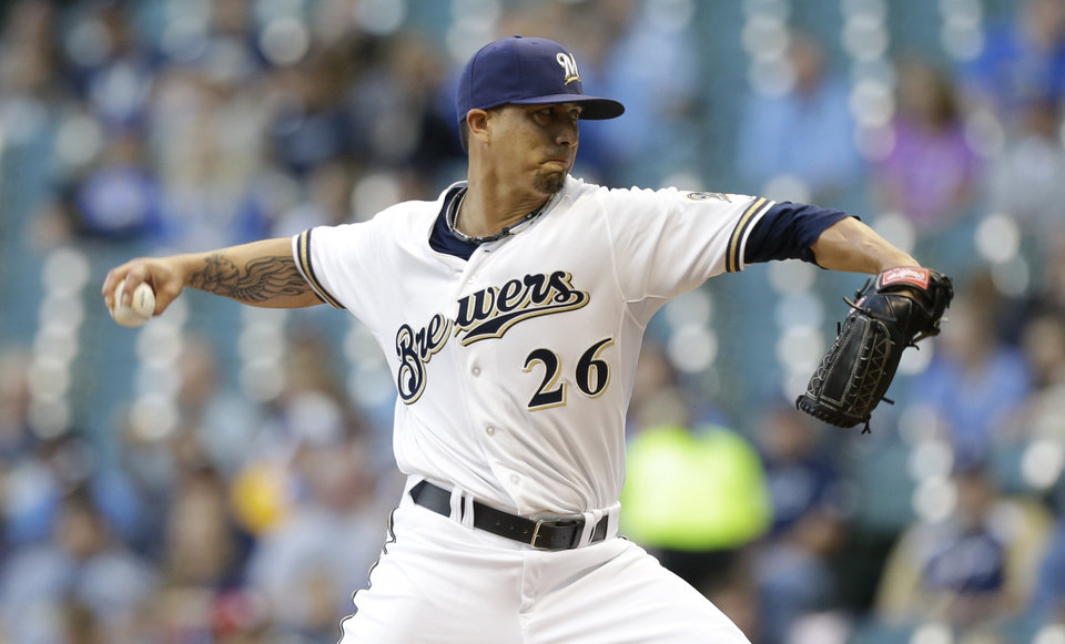 Photo - Milwaukee Brewers starting pitcher Kyle Lohse throws against the San Diego Padres during the first inning of a baseball game on Wednesday, July 24, 2013, in Milwaukee. (AP Photo/Jeffrey Phelps)