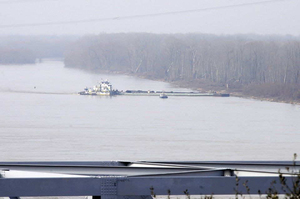 Photo - The towboat Nature Way Endeavor banks a barge against the western bank of the Mississippi River, Sunday, Jan. 27, 2013. The river was closed to all traffic eight miles north and south of Vicksburg. (AP Photo/Vicksburg Post, Eli Baylis)