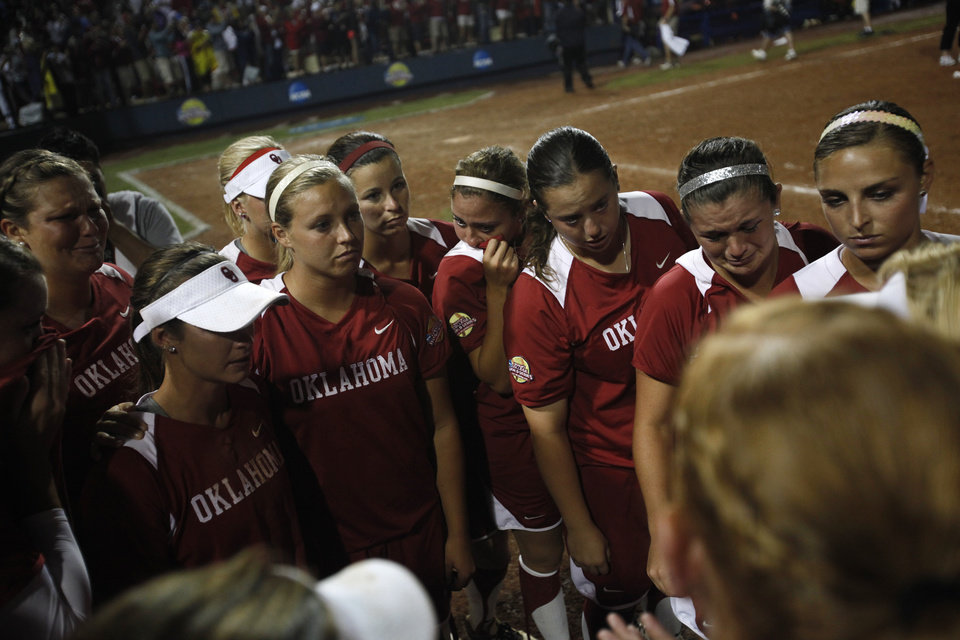 The Oklahoma Sooners react after a loss against Alabama in the Women's College World Series softball championship at ASA Hall of Fame Stadium in Oklahoma City, Thursday, June 7, 2012.  Photo by Garett Fisbeck, The Oklahoman