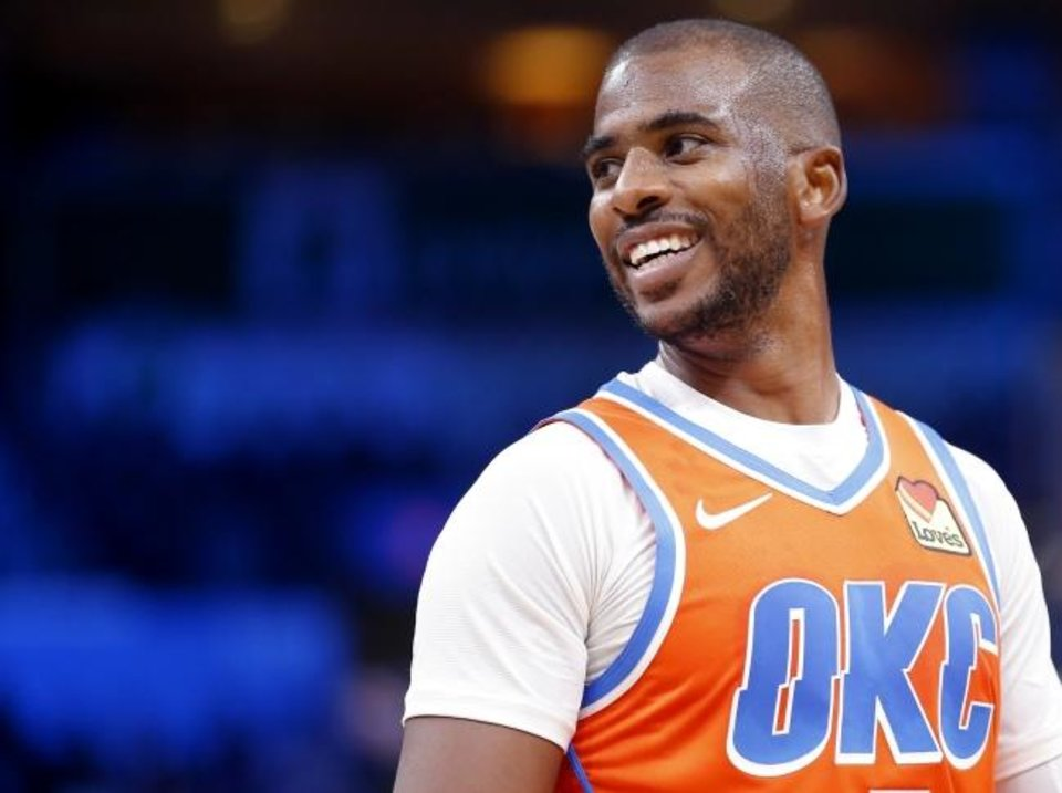 Photo -  The mood around the Thunder has been lighter this season. In this photo, Oklahoma City's Chris Paul laughs as he talks to a referee during a recent game at Chesapeake Energy Arrena. [Sarah Phipps/The Oklahoman]