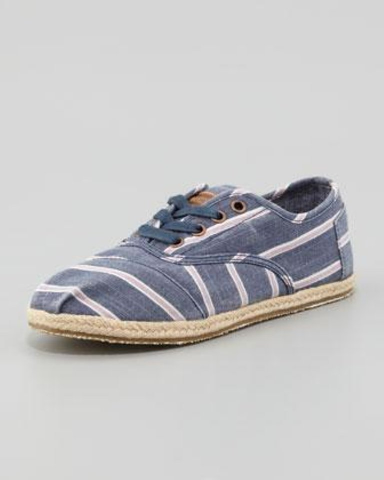 Photo -  Toms Cordones canvas navy and white stripe, $69, at Neiman Marcus.