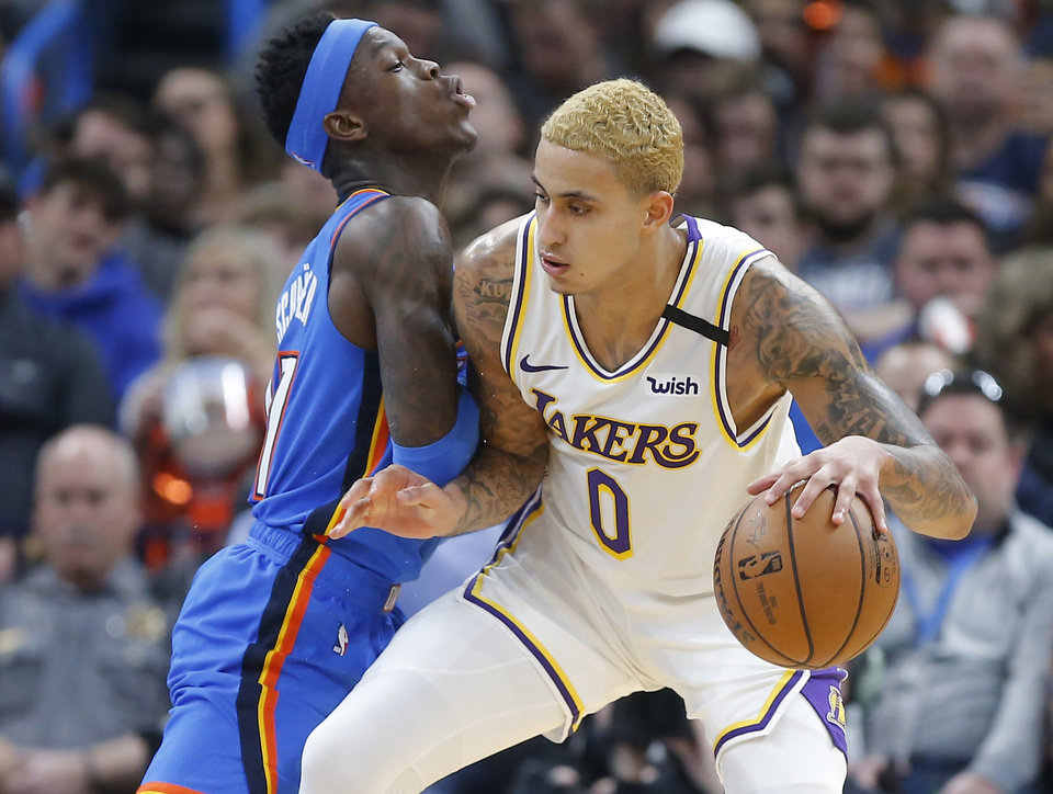 Photo - Oklahoma City's Dennis Schroder (17) defends Los Angeles' Kyle Kuzma (0) during an NBA basketball game between the Oklahoma City Thunder and Los Angeles Lakers at Chesapeake Energy Arena in Oklahoma City, Saturday, Jan. 11, 2020. [Bryan Terry/The Oklahoman]