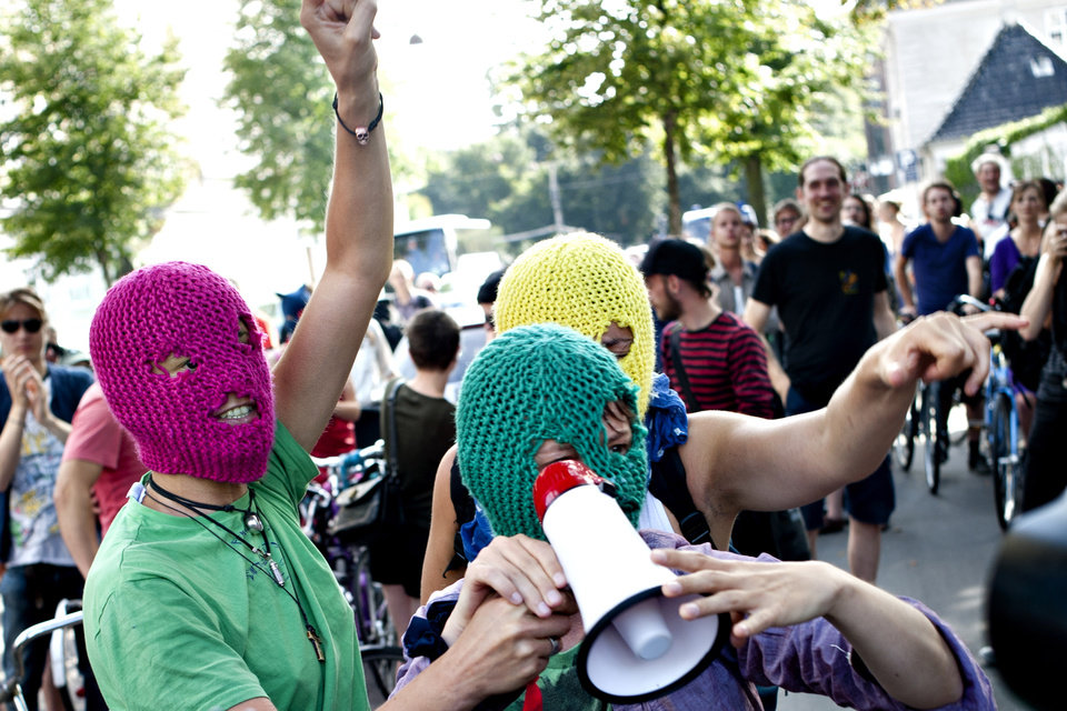 Photo -   Demonstrators talk on a megaphone in support of the Russian punk group Pussy Riot during a protest in front of the Russian Embassy in Copenhagen, Denmark, Thursday Aug. 17, 2012. Three members of Pussy Riot were jailed in March and charged with hooliganism motivated by religious hatred after their punk performance against President Putin in Moscow's main cathedral. Russian court sentences Pussy Riot members to 2 years in prison each. (AP Photo/Polfoto/Liv Hoybye) DENMARK OUT