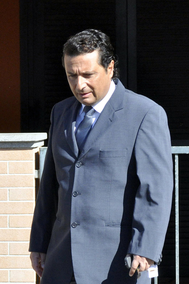 Photo - FILE -- In this file photo taken in Grosseto on May 14 2013ormer captain of the Costa Concordia luxury cruise ship Francesco Schettino leaves his house to attend a closed-door hearing. The Italian captain of the Costa Concordia cruise ship was ordered on Wednesday to stand trial for manslaughter in the luxury liner's shipwreck off the coast of Tuscany, which killed 32 people. Judge Pietro Molino, at a closed door hearing in the town of Grosseto, agreed to prosecutors' requests that Francesco Schettino should be tried on charges of manslaughter, causing the shipwreck and abandoning the vessel while many of the 4,200 passengers and crew were still aboard. (AP Photo/Giacomo Aprili)