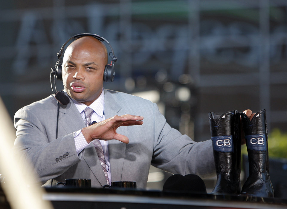 Photo - Charles Barkley holds a pair of boots on the TNT set before game three of the Western Conference Finals in the NBA playoffs between the Oklahoma City Thunder and the San Antonio Spurs at Chesapeake Energy Arena in Oklahoma City, Thursday, May 31, 2012. Photo by Sarah Phipps, The Oklahoman