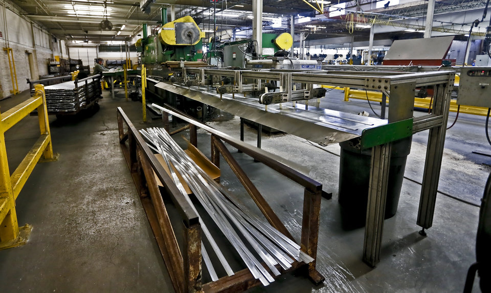 Aluminum strips are cut and drilled for floor stripping at the MD Building Products plant on Wednesday, Jan. 2, 2013, in Oklahoma City, Okla. Photo by Chris Landsberger, The Oklahoman