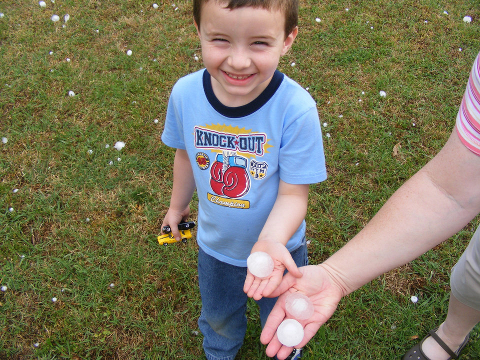 Cute photo of my son, Shawn Lippe Jr, of Midwest City holding the hail from 5.1.08. His T-Shirt says it all. lol<br/><b>Community Photo By:</b> Shawn Lippe, Sr.<br/><b>Submitted By:</b> Karen, Midwest City