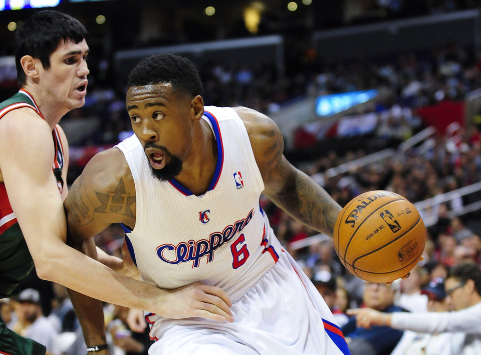 Photo - Los Angeles Clippers center DeAndre Jordan (6) drives on Milwaukee Bucks forward Ersan Ilyasova, left, of Turkey, in the first half of an NBA basketball game, Wednesday, March 6, 2013, in Los Angeles.(AP Photo/Gus Ruelas)