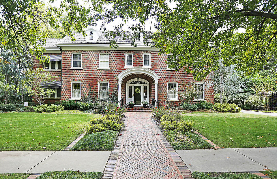 Photo - Kyle and Sara Sweet's home at 300 NW 15 is one of several historic homes on the Heritage Hills home tour, from noon to 5 p.m. Saturday and Sunday.  Steve Gooch - The Oklahoman