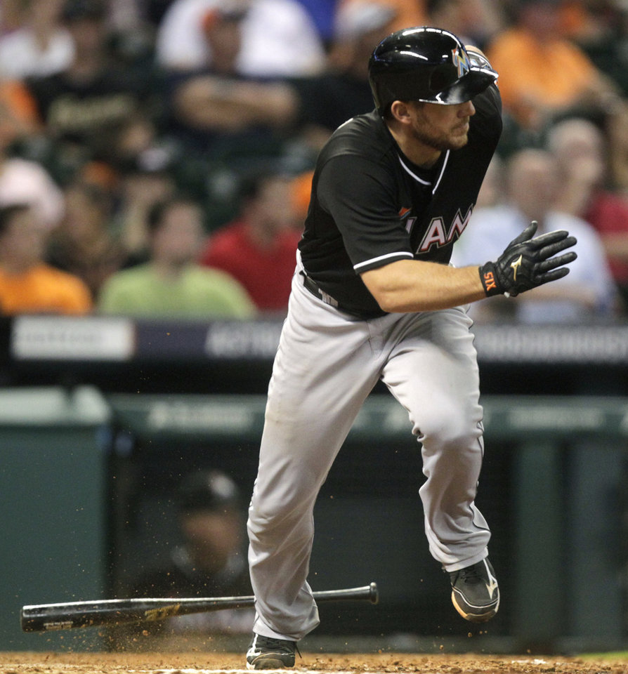 Photo - Miami Marlins' Jeff Mathis hits a double to left field that scored Jarrod Saltalamacchia and Adeiny Hechavarria during the seventh inning of a baseball game against the Houston Astros, Friday, July 25, 2014, in Houston. (AP Photo/Patric Schneider)