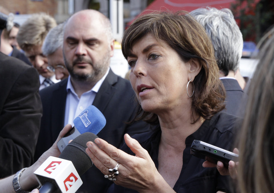 Photo - Interior Minister Joelle Milquet addresses the media near the site of a shooting at the Jewish museum in Brussels, Saturday, May 24, 2014. Belgian officials say that at least three people have been killed in gunfire at the Jewish Museum in Brussels. Belgian Foreign Minister Didier Reynders, in a post on Twitter, said he was