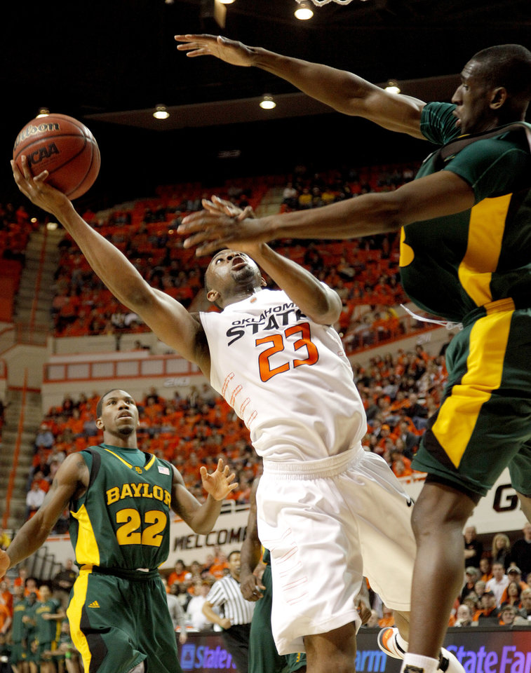 Photo - OSU's James Anderson goes to the basket between Baylor's A.J. Walton, left, and Ekpe Udoh during an NCAA college basketball game between Oklahoma State University and Baylor at Gallagher-Iba Arena in Stillwater, Okla., Saturday, Feb. 20, 2010.  Photo by Bryan Terry, The Oklahoman ORG XMIT: KOD