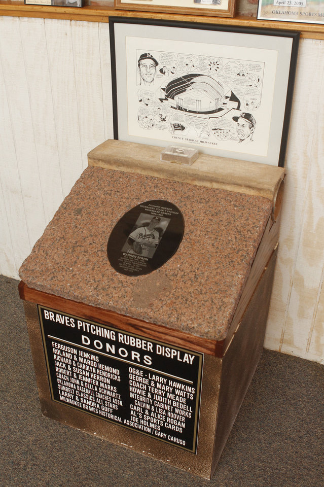 Photo - BASEBALL COLLECTION: This Braves pitching rubber is on display at the Oklahoma Sports Hall of Fame in Guthrie, OK, Thursday, April 11, 2013,  By Paul Hellstern, The Oklahoman