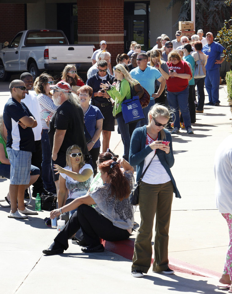 Tornado victims wait in line Monday outside the First Baptist Church in Moore, where Cantor Fitzgerald volunteers are distributing gift cards. PHOTO BY PAUL SOUTHERLAND, THE OKLAHOMAN <strong>PAUL B. SOUTHERLAND</strong>