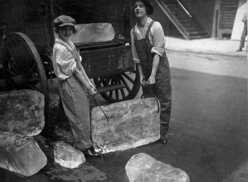 Photo - This 1918 photo provided by the National Archives, Records of the War Department General and Special Staffs Smithsonian InstitutionTraveling Exhibition Service shows young women delivering ice. The photo is part of